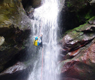 Canyoning through a waterfall in Madeira