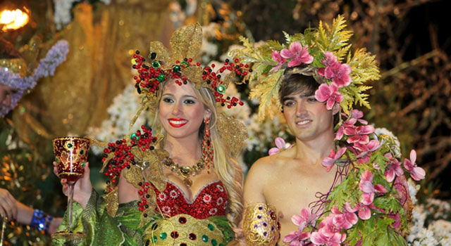 a couple in a parade at Madeira Carnival
