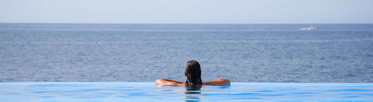 Girl at Vidamar pool looking to the sea